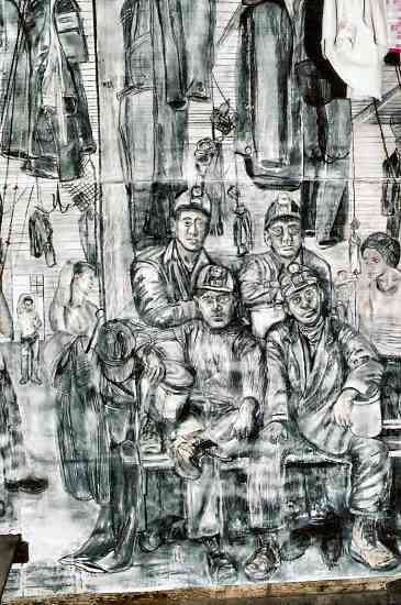 2. Image of a wall mural in the shower and change room that depicts miners