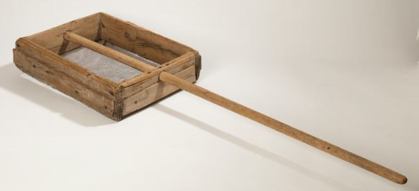 3. Photo of a roughly hewn ash sifter from the late 19th century