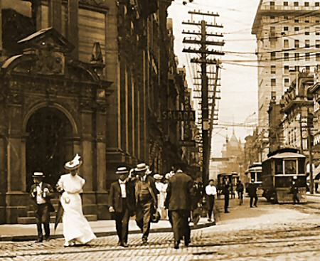 1. Image of a well-dressed lady and several men crossing a Toronto street in 1890