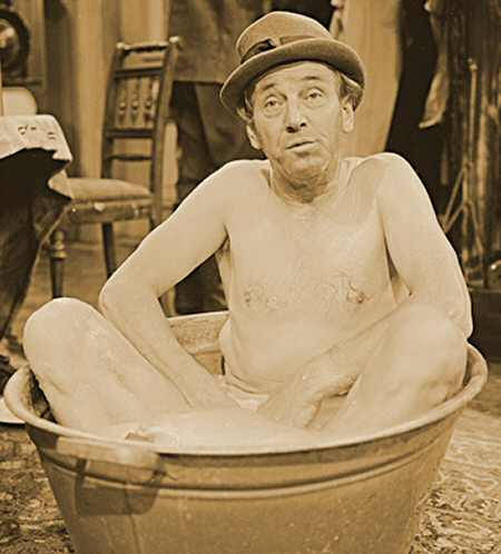 1. Image of a man sitting in a tin tub