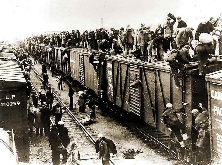 2. Photo of unemployed men hopping onto a train in 1933