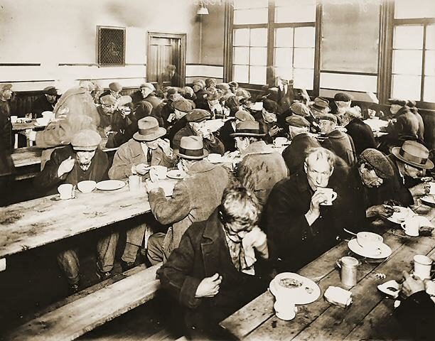 4. Photo of people eating at a soup kitchen