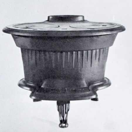 4. Image of a compact 1896 fisherman's two-burner boat stove