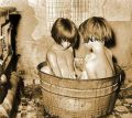 3. Photo showing kids bathing in a small metal tub