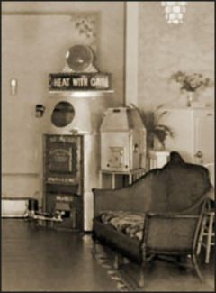 1. Image shows a gas furnace on display in a booth in 1934