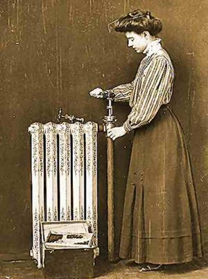 Image of a woman repairing a hot water radiator