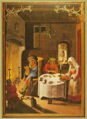 1. Image of people at a table in front of a roaring fire